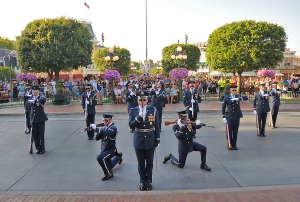 Members of the U.S. Air Force Honor Guard drill team perform for spectators at Disneyland, May 20. The drill team performs to represent the Airmen serving around the world in the Air Force.