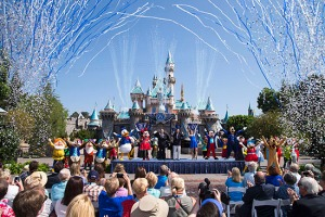 """DAZZLING DAY - Mickey Mouse and his friends celebrate the 60th anniversary of Disneyland park during a ceremony at Sleeping Beauty Castle featuring Academy Award-winning composer, Richard Sherman and Broadway actress and singer Ashley Brown, in Anaheim, Calif. on Friday, July 17. Celebrating six decades of magic, the Disneyland Resort Diamond Celebration features three new nighttime spectaculars that immerse guests in the worlds of Disney stories like never before with """"Paint the Night,"""" the first all-LED parade at the resort; """"Disneyland Forever,"""" a reinvention of classic fireworks that adds projections to pyrotechnics to transform the park experience; and a moving new version of """"World of Color"""" that celebrates Walt Disney's dream for Disneyland. (Paul Hiffmeyer/Disneyland Resort)"""