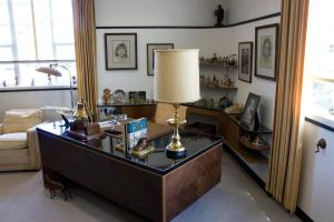 This is Walt Disney's formal office in the 3H wing of the Animation Building on the Walt Disney Studios lot in Burbank. The office was restored in it original location with nearly all the original furniture and other items by the Disney Archives as part of a project for the studio's 75th Anniversary. Disney employees, and visitors to the studio will be able to view the office in 2016. //// ADDITIONAL INFORMATION: Walt Disney's original offices at the Walt Disney Studios were restored to the state they were in when he was alive and worked there. They are located on the third floor of the Animation Building in the 3H wing.  Date of photo: 12/7/15. - disney.waltsoffice - Photo by MARK EADES, STAFF PHOTOGRAPHER