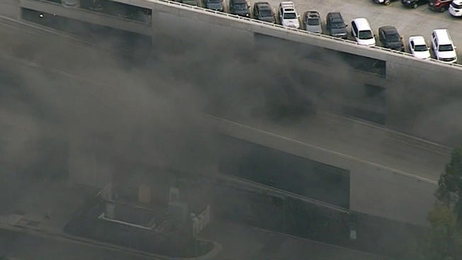7 People Treated, 8 Cars Burn In Disneyland Parking Structure Fire