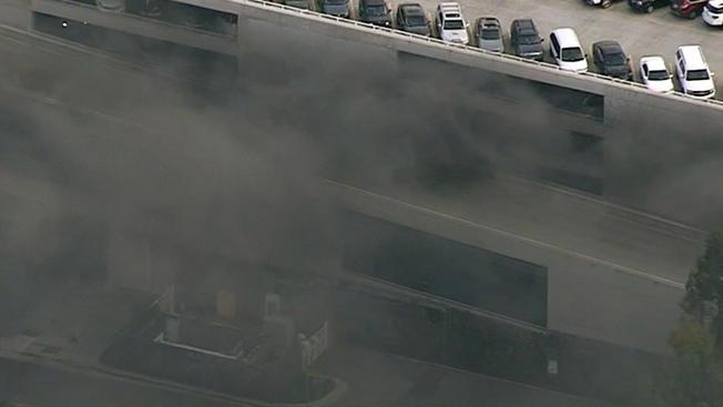 7 People Treated, 8 Cars Burn In Disneyland Parking StructureFire